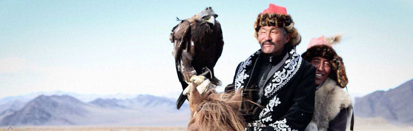 Mongolian eagle hunters on horseback