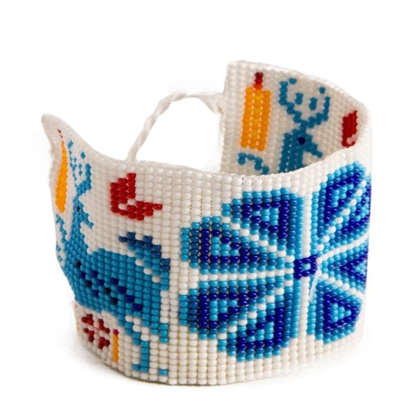Blue beaded Huichol bracelets with traditional symbols and patterns. Made by local artisans, buy fair trade mexican jewellery bracelets online. From Beshlie Mckelvie.