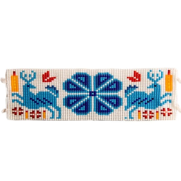 Blue flat beaded Huichol bracelets with traditional symbols and patterns. Made by local artisans, buy fair trade mexican jewellery bracelets online. From Beshlie Mckelvie.