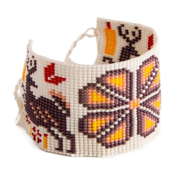 Purple beaded Huichol bracelets with traditional symbols and patterns. Made by local artisans, buy fair trade mexican jewellery bracelets online. From Beshlie Mckelvie.