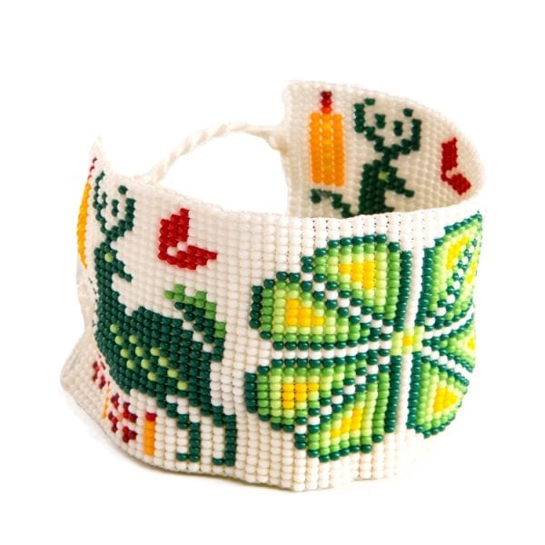 Green beaded Huichol bracelets with traditional symbols and patterns. Made by local artisans, buy fair trade mexican jewellery bracelets online. From Beshlie Mckelvie.