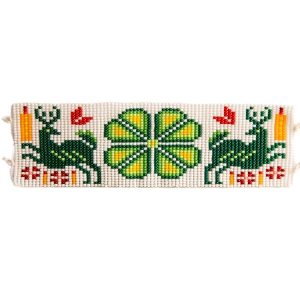 Green flat beaded Huichol bracelets with traditional symbols and patterns. Made by local artisans, buy fair trade mexican jewellery bracelets online. From Beshlie Mckelvie.