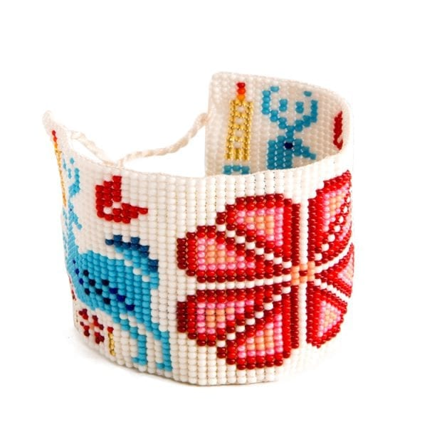 Red beaded Huichol bracelets with traditional symbols and patterns. Made by local artisans, buy fair trade mexican jewellery bracelets online. From Beshlie Mckelvie.