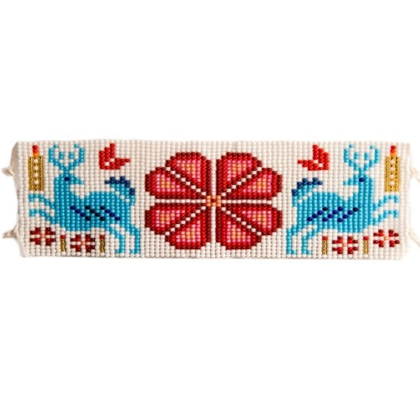 Red flat beaded Huichol bracelets with traditional symbols and patterns. Made by local artisans, buy fair trade mexican jewellery bracelets online. From Beshlie Mckelvie.