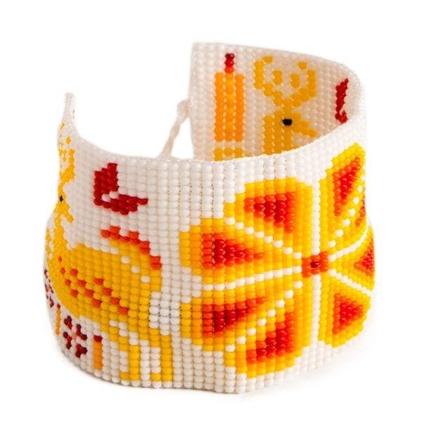 Yellow beaded Huichol bracelets with traditional symbols and patterns. Made by local artisans, buy fair trade mexican jewellery bracelets online. From Beshlie Mckelvie.