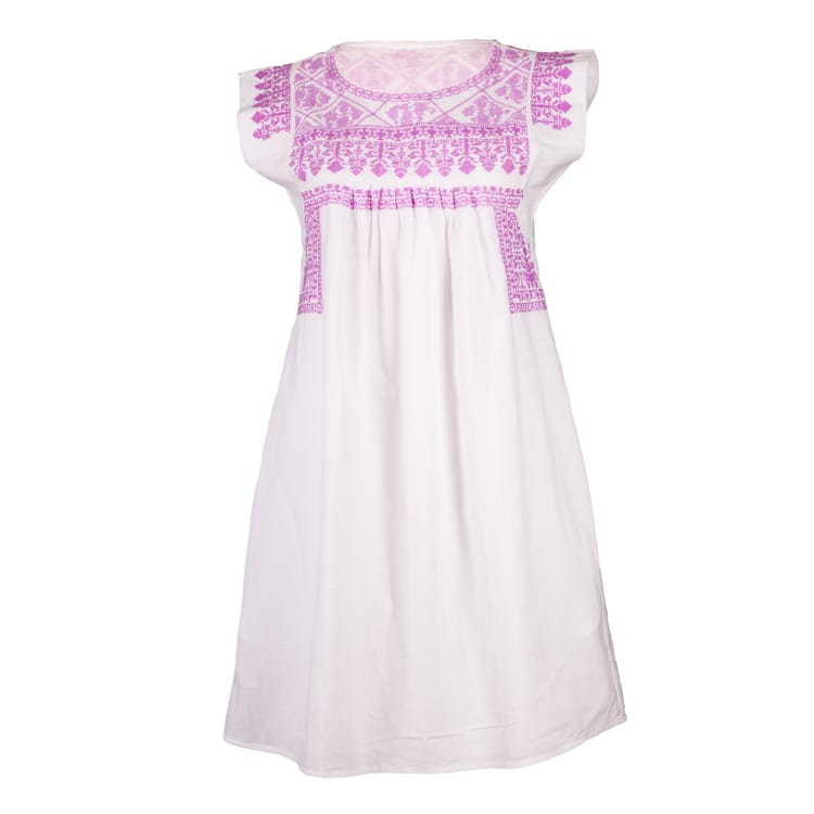 The beautiful neckline of this Nomadic Gypsy Lilac dress with hand embroidery in a range of beautiful soft colors makes it such a pretty summer dress. From Beshlie Mckelvie.