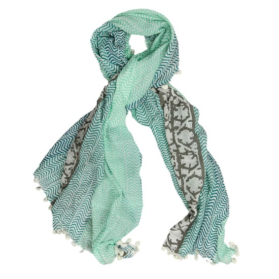 The Massi scarf is a beautiful hand woven and printed piece in hues of aqua and blue with a delicate pattern. Buy ethical scarves from Beshlie.