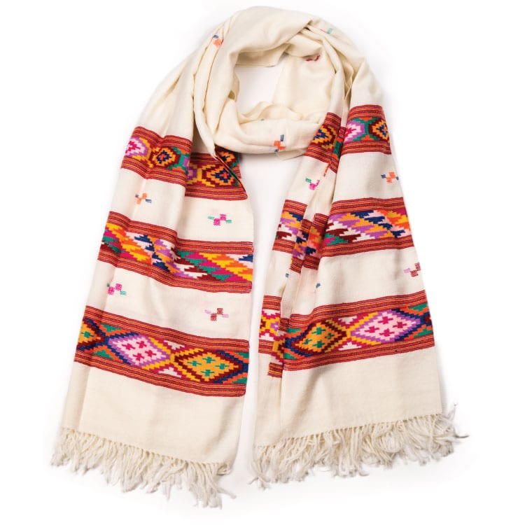 Himalaya hand woven wool shawl is a rainbow of color set on a cream background with hand woven luxurious merino wool that can be styled in a number of ways.