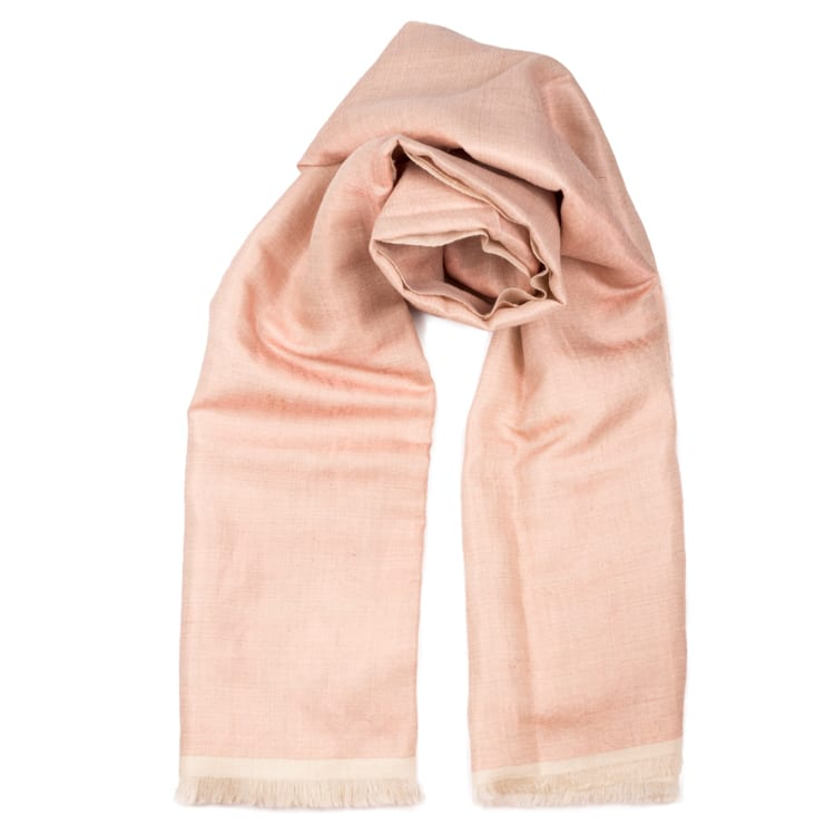The cashmere Dorukha shawl is a double sided handwoven scarf. It has shimmery threads on one side & pearly pink solid on the reverse. From Beshlie Mckelvie.