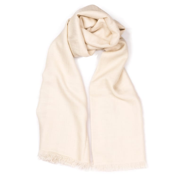 This Ultimate Band cashmere shawl is handwoven in ivory with a delicate silver band. Perfect for spring & summer, it can be styled up in number of ways. From Beshlie Mckelvie.