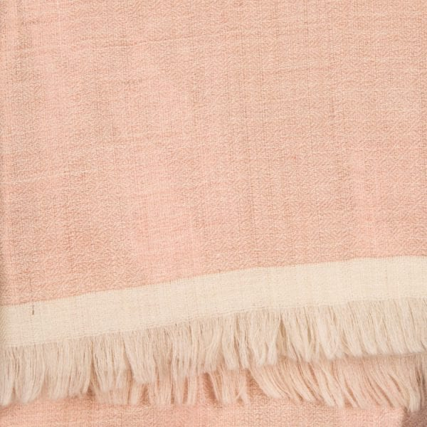 Close up detail of the cashmere Dorukha shawl is a double sided handwoven scarf. It has shimmery threads on one side & pearly pink solid on the reverse. From Beshlie Mckelvie.