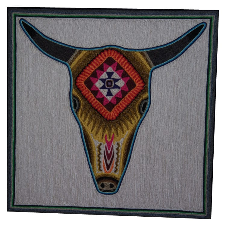 Stunning traditional Huichol art yarn painting featuring the bull's head in gold & orange. Buy fair trade Mexican textiles & support Huicol communities.