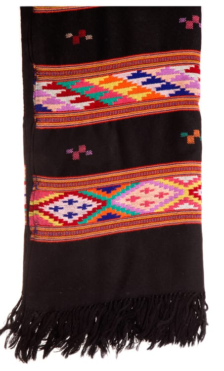 Close up of handwoven himalaya scarf in black with colourful pattern