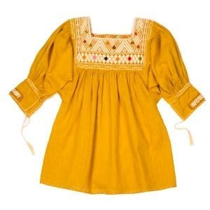 This mustard Mexican Peasant mini dress for children has beautiful hand embroidery beautifully around the neck and cute hanging tassels at the sleeves.