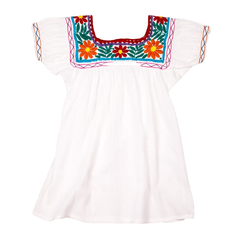 Blue and red trim. Hand Embroidered Mexican Classic mini dress for children. Beautiful neck line with funky colours on a white base, your little one will love it. From Beshlie Mckelvie.