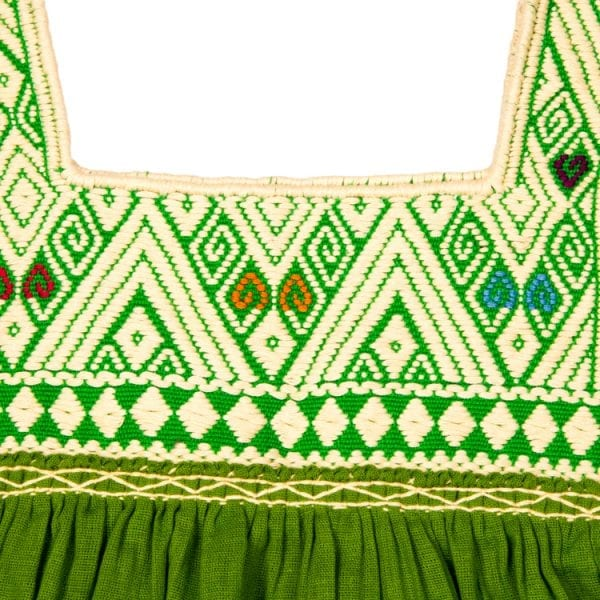 Close up detail of embroidery. This olive Mexican Peasant mini dress for children has beautiful hand embroidery beautifully around the neck and cute hanging tassels at the sleeves.