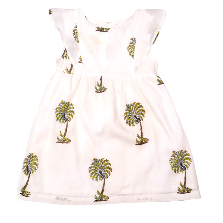 Made with 100% organic cotton, this Green Palm Children's dress is perfect for summers. The Hand block printed green palm make it super cute. From Beshlie Mckelvie.