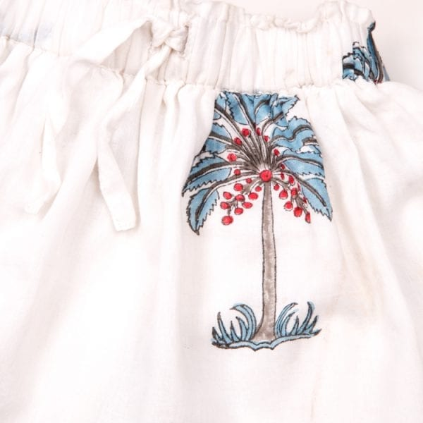 Close up detail of blue palm design. Made up of 100% cotton this Mini Nomadic Playa Print Skirt is Hand Block printed with cute blue palms making it adorable for your little one. From Beshlie Mckelvie.