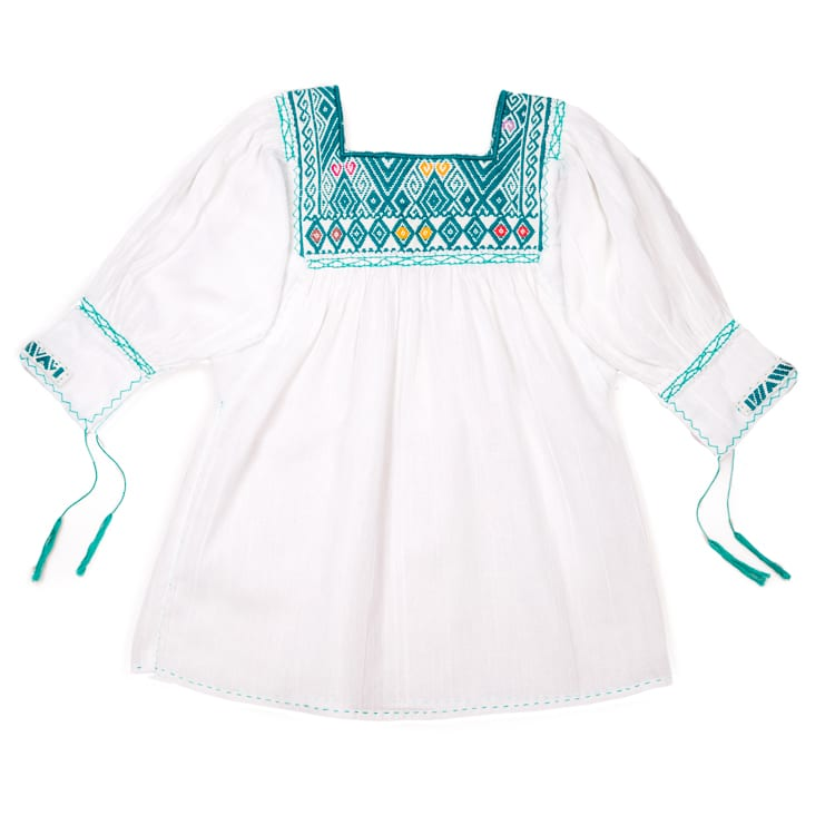 Children love this Mexican Gypsy Dress with it's beautiful hand embroidery around the neck and tasseling on the arms adding the cute factor. From Beshlie Mckelvie.