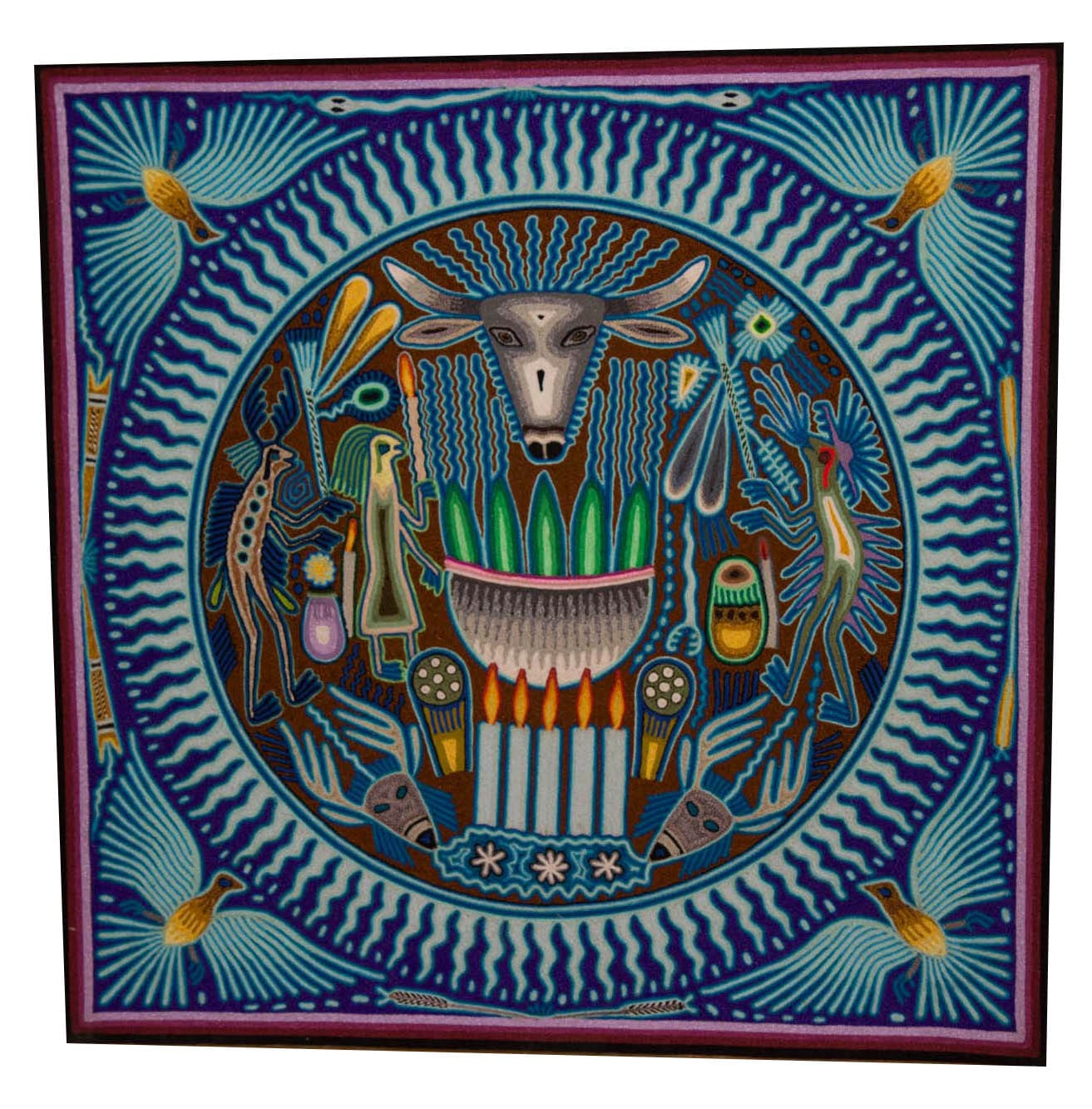 Stunning traditional Huichol art yarn painting featuring nature motifs in blue. Buy fair trade Mexican textiles & support local Huicol communities.