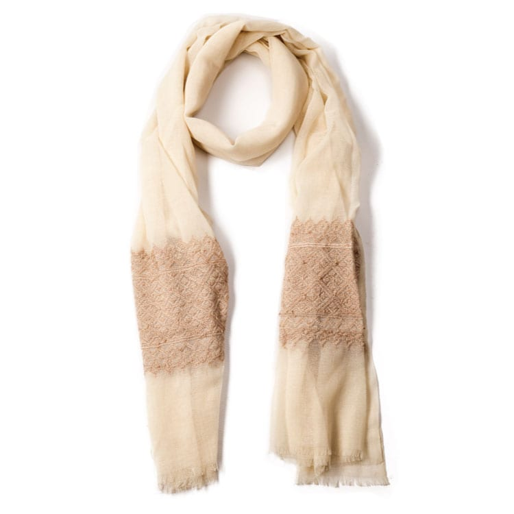 This Syrian hand embroidered scarf in neutral tones, hand woven from camel hair just to bring that extra soft touch. Perfect for any outfit. From Beshlie Mckelvie.