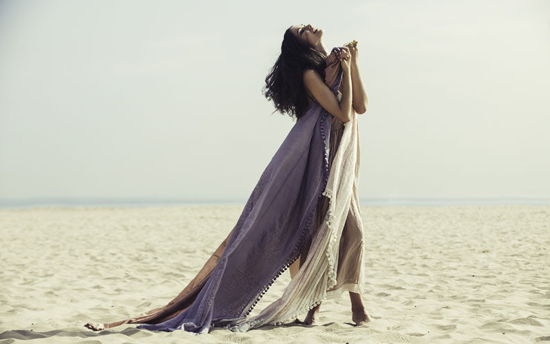 Model on beach clasps long flowing scarf from Beshlie Mckelvie