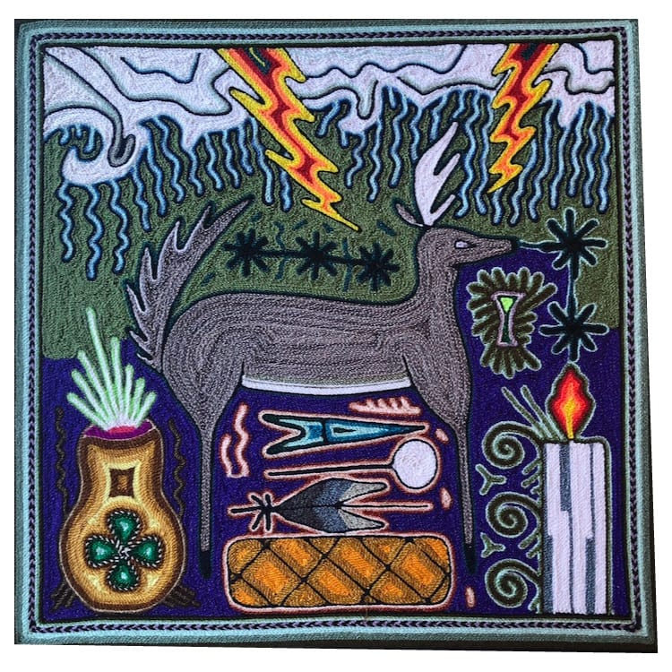 Stunning traditional Huichol art yarn painting featuring a bull's head. Buy fair trade Mexican textiles and support local Huicol artisans and communities.