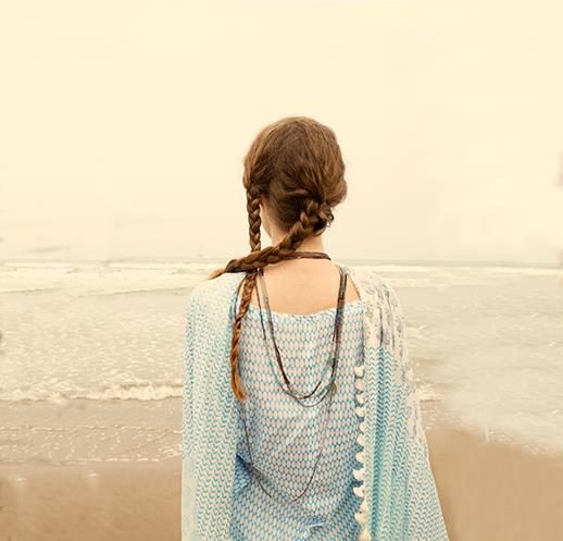 Model looks out to the ocean wearing sustainable fashion from Beshlie Mckelvie