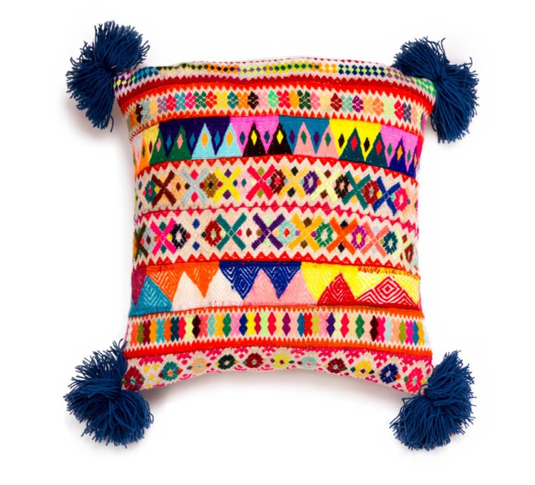 Peruvian Pom Pom Cushions in Blue are beautiful hand woven ribbon cushions. The vibrant Blue colour will make a feature in any home. Buy fair trade today. From Beshlie Mckelvie.
