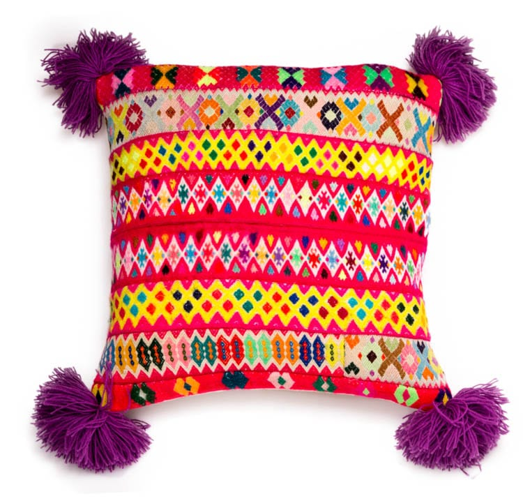 Beautiful hand woven Peruvian Pom Pom Cushions in purple will steal your heart with its unique design and colour. Buy fair trade from Beshlie Mckelvie today.