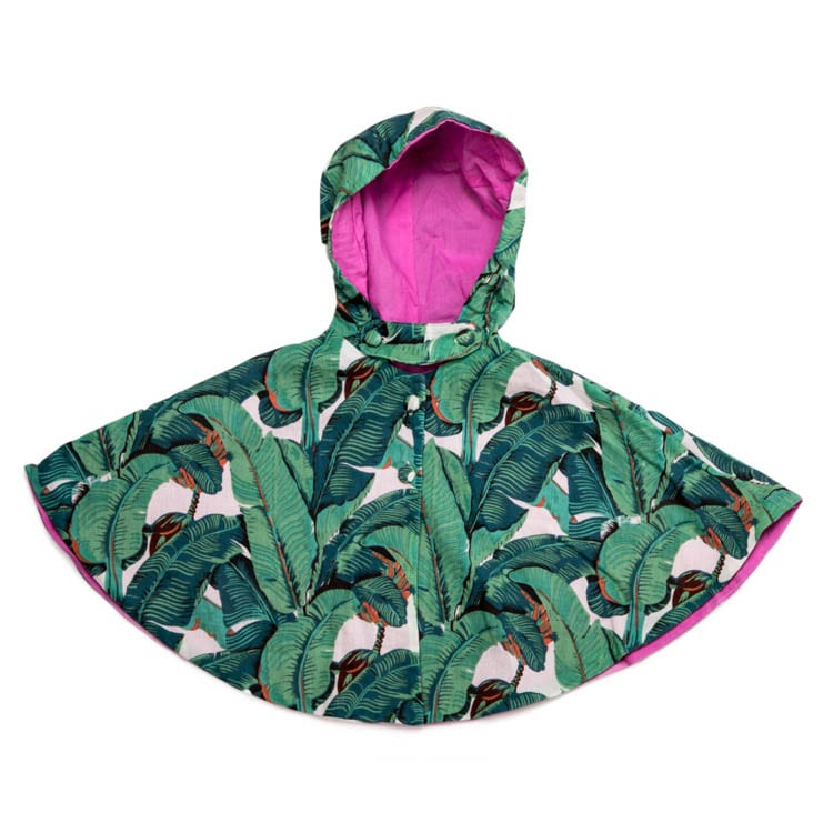 The Mini Forest Cape is a hand screen printed cotton children's cape with hood in a rain forest pattern with a bright pink cotton lining. Adorable! From Beshlie Mckelvie.