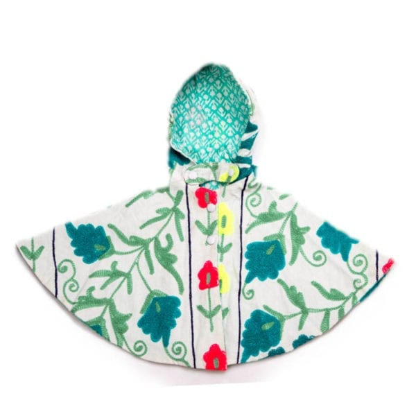 Suzani, a children's Cape created by block printing and hand embroidery. Bright, colourful pattern and a cotton lining. From Beshlie Mckelvie.