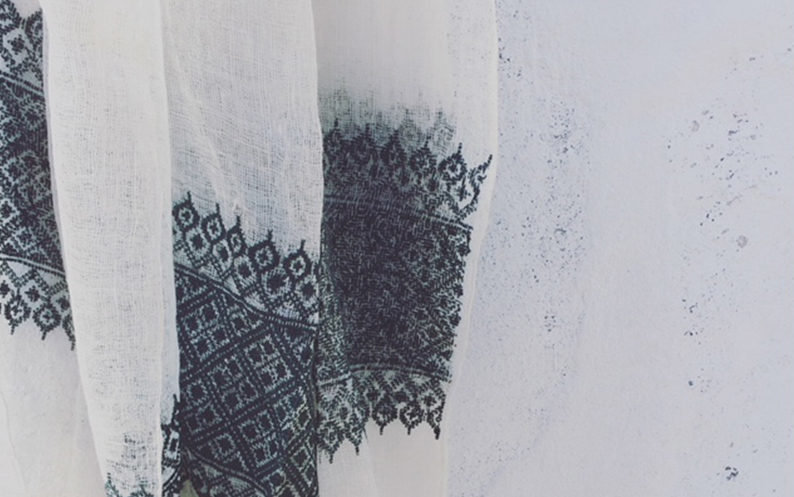Beautiful black embroidery on white scarf