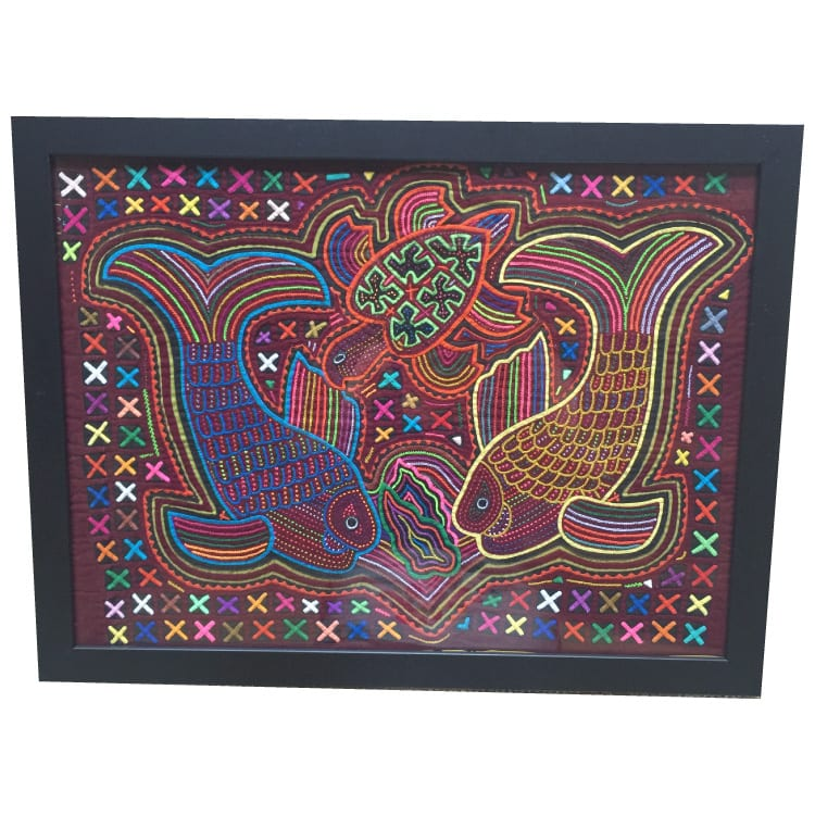 Created by Kuna women, molas are a traditional art form hand made with layers of cloth. This textile features a marine motif of a turtle & fish embroidered. From Beshlie Mckelvie