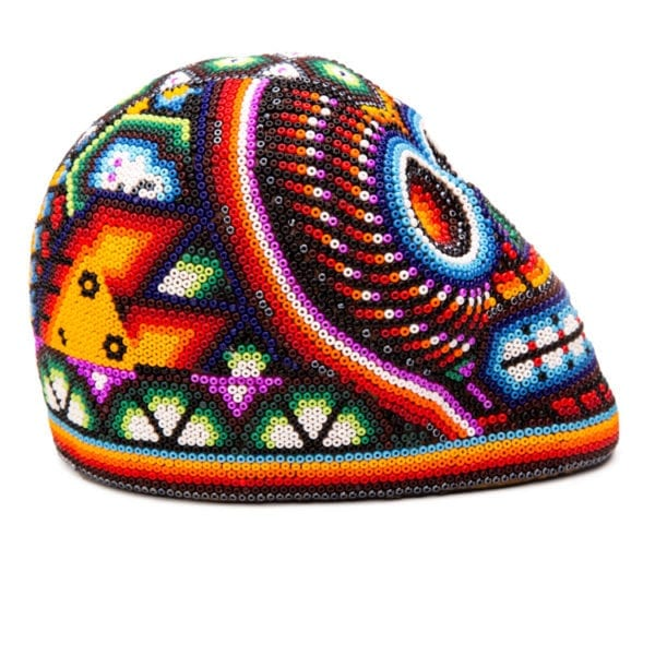 Side angle - Colourful Calavera Huichol. The Mexican beadwork in Huichol art work uses traditional patterns that have been used for centuries communicate with the gods. From Beshlie Mckelvie.