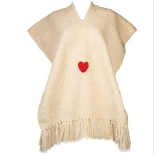 The Corazon Poncho is Hand loomed by artisans in Argentina with 100 % Natural wool. Stunning design with neutral background and heart detail. From Beshlie Mckelvie.