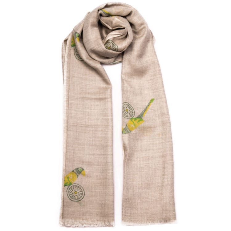Hand block printed cashmere scarf with a Tropicana design in a yellow and lime with gold on a neutral background with a beautiful yellow parrot feature. From Beshlie Mckelvie.