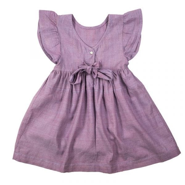Back of classic style mini nomadic dress hand loomed in Khadi cotton. This lavander girls dress has a tie at the back, frill sleeves & mother of pearl buttons. From Beshlie Mckelvie.
