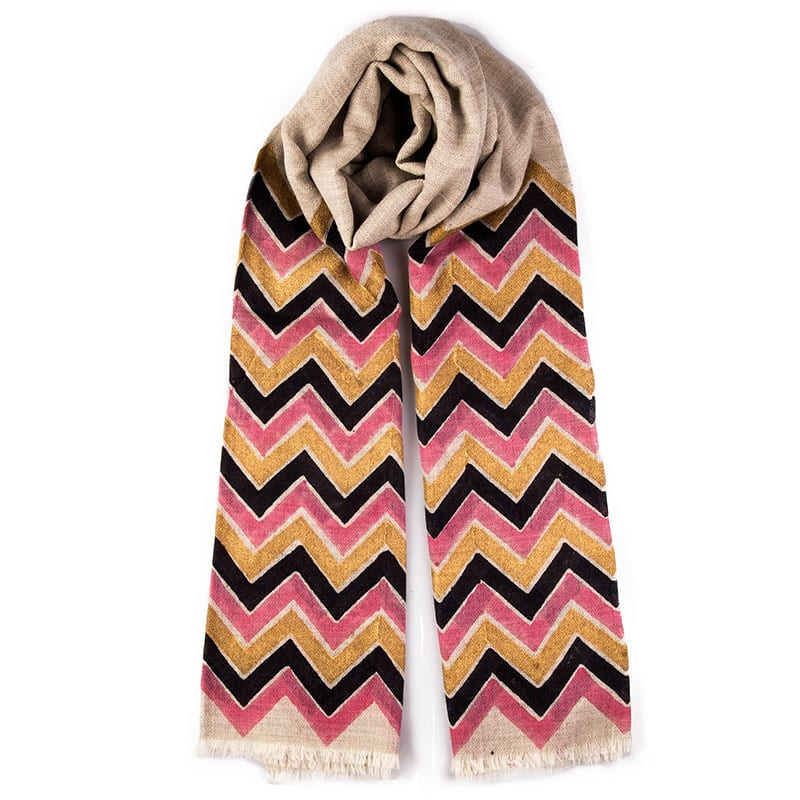 Hand block printed Calli cashmere scarf design has a bold zig zag print in pink, indigo blue and gold on a neutral background. This is a very pretty shawl. From Beshlie Mckelvie.