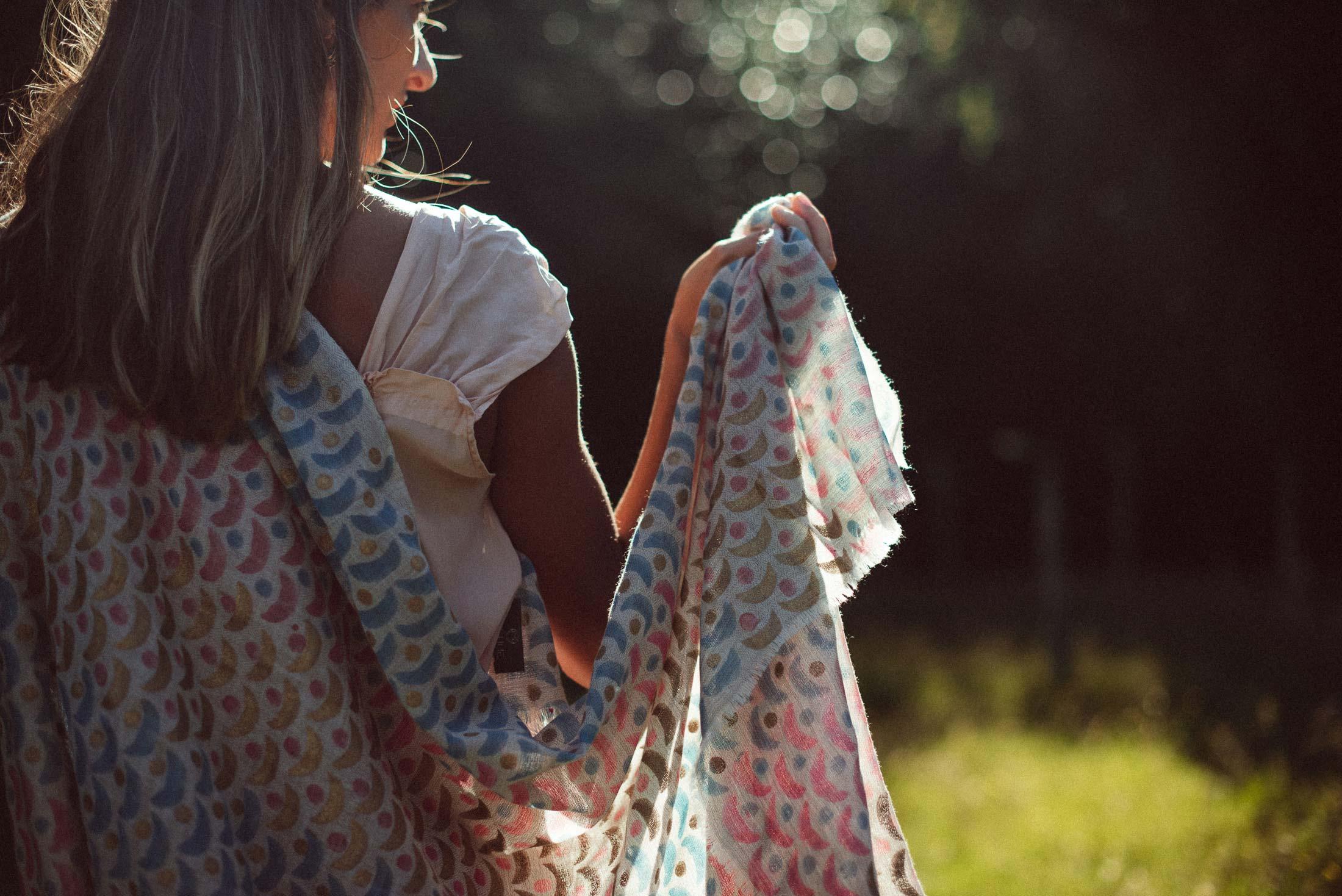 Model walks through meadow in Beshlie Mckelvie scarf