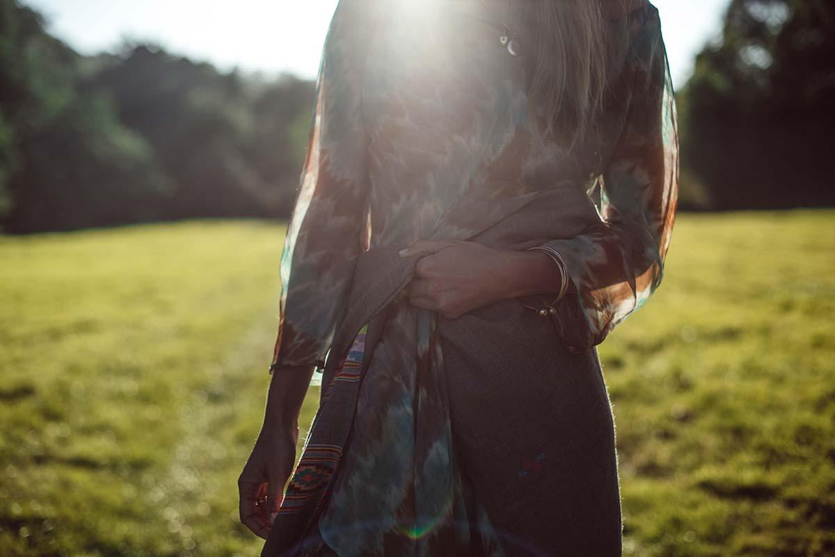 Beshlie Mckelvie sustainable fashion cashmere hand woven shawl wrap worn in sunlit field