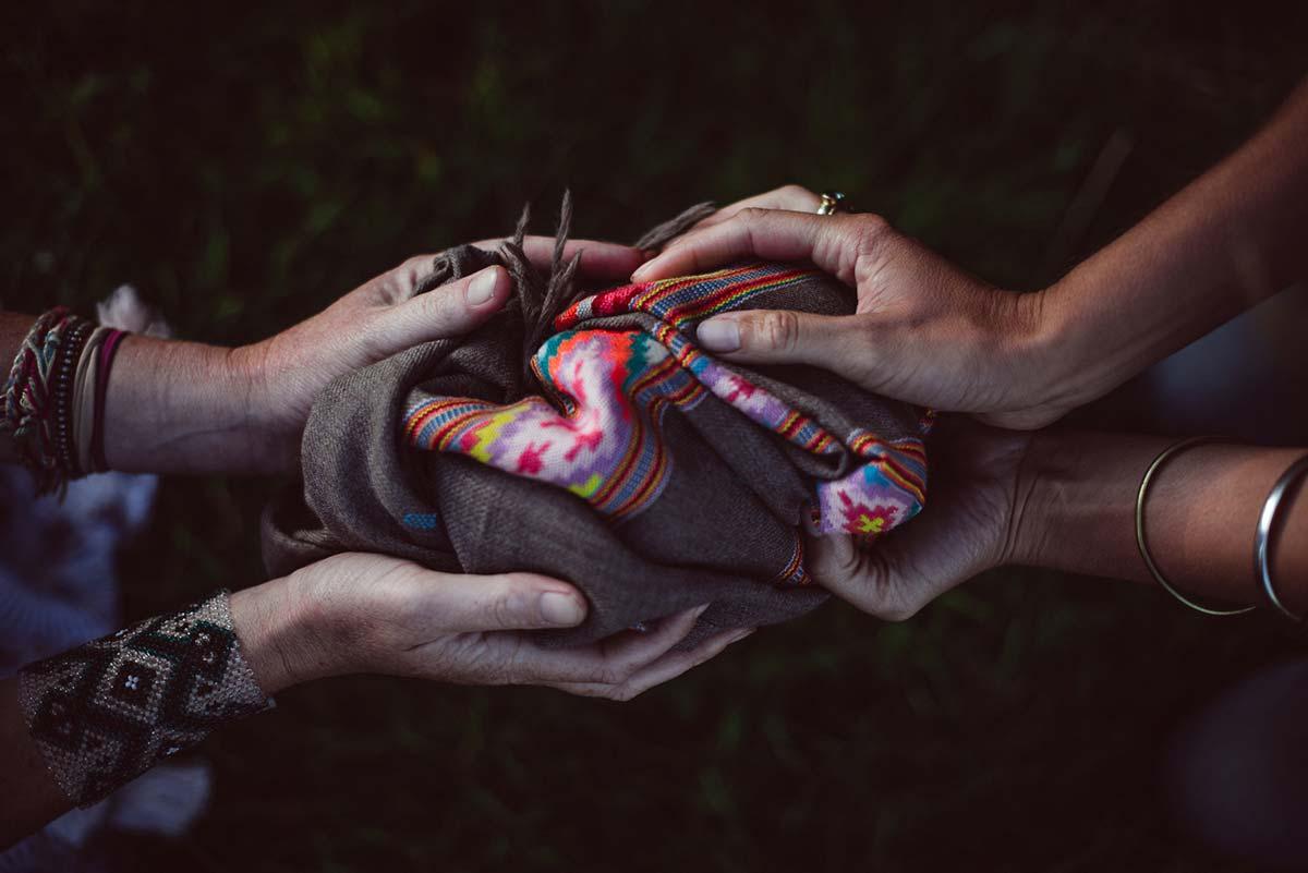 Pair of hands hold a Beshlie Mckelvie stunning ladies hand woven cashmere scarf
