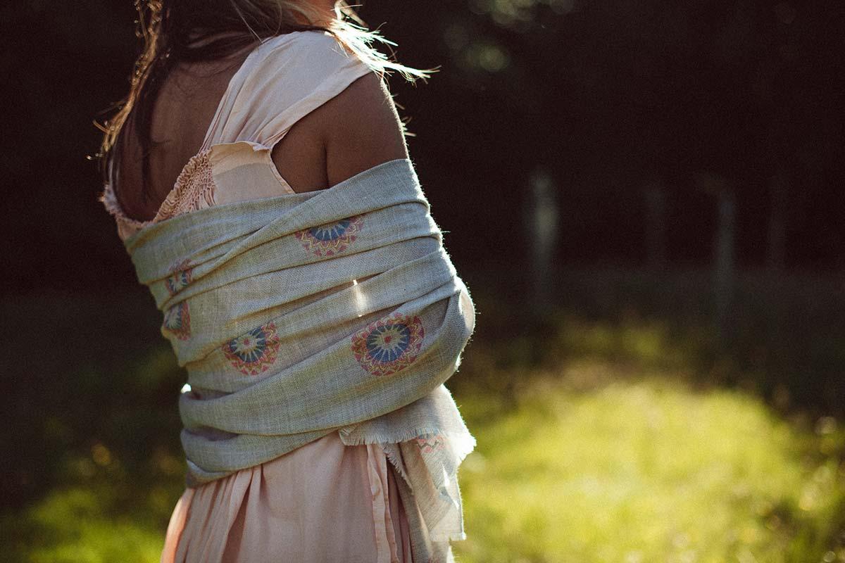 Beshlie Mckelvie sustainable fashion cashmere hand woven shawl pashmina worn in sunlit field