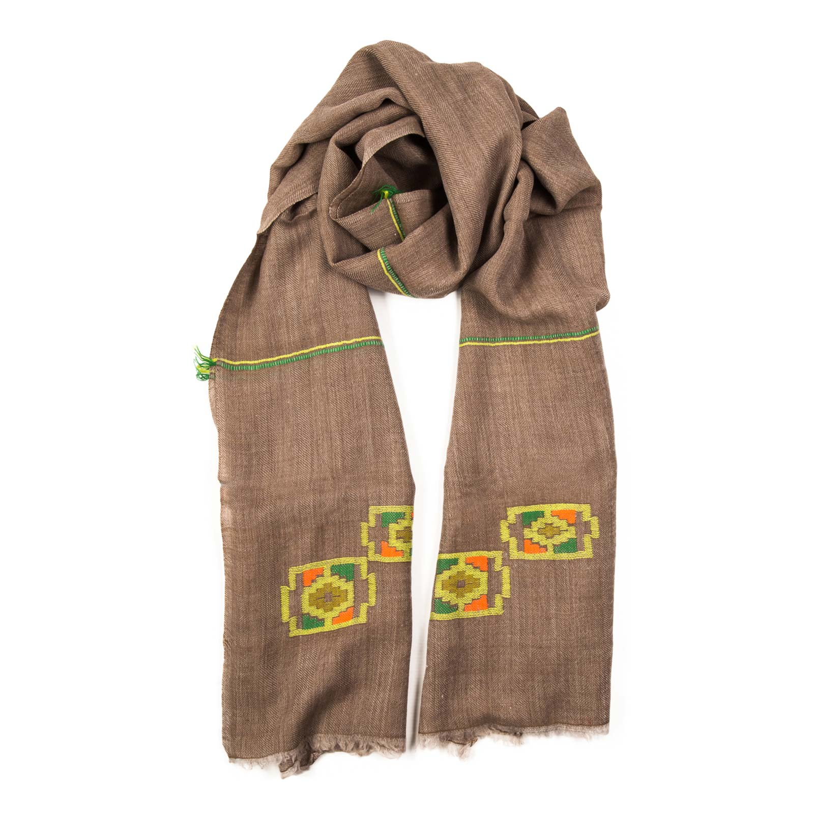 Pluto hand woven shawl bursts with neon color set on a natural background. Hand woven and luxurious lightweight Pashmina. It can be styled in a number of ways with a generous width and length. From Beshlie Mckelvie.