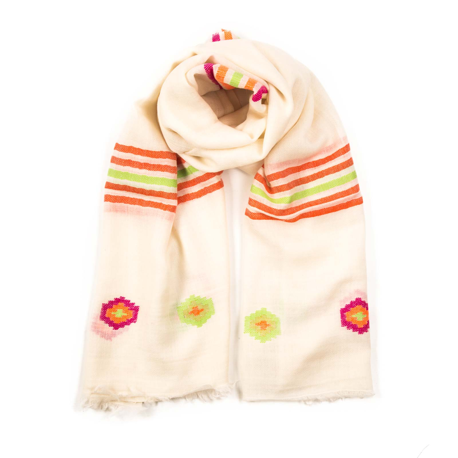 Saturn rainbow shawl bursts with a rainbow of color set on a white background. Made up of luxurious Pashmina, the shawl is purely hand woven. From Beshlie Mckelvie