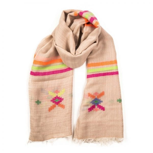 The Jupiter scarf bursts with a rainbow of color set on a white background. A luxurious and lightweight pashmina, this stunning shawl is purely hand woven.