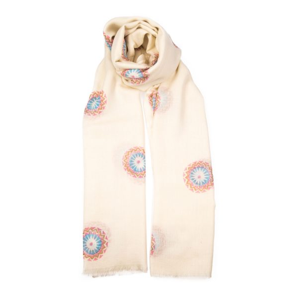 Hand block printed Beltane design is printed in a pale blue, blush pink and gold design on a white background. This is an elegant and very pretty cashmere shawl from Beshlie Mckelvie.