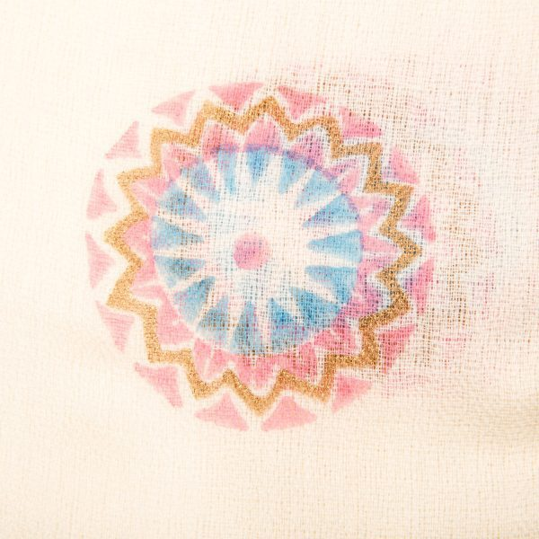Close up detail of Hand block printed scarf Autumn mandala design is printed in a pale blue, blush pink & gold design on a neutral background. An elegant cashmere shawl. From Beshlie Mckelvie