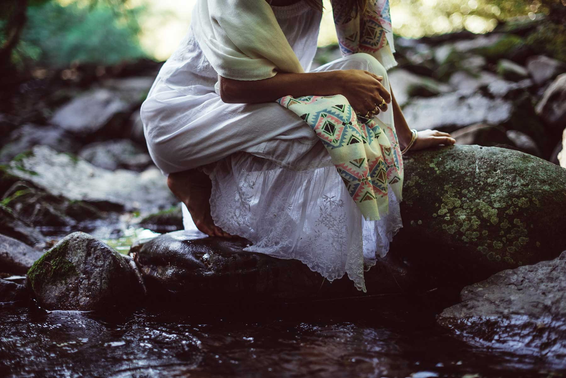 Kneeling by a stream in Beshlie Mckelvie's ethical fashion dresses and scarves.