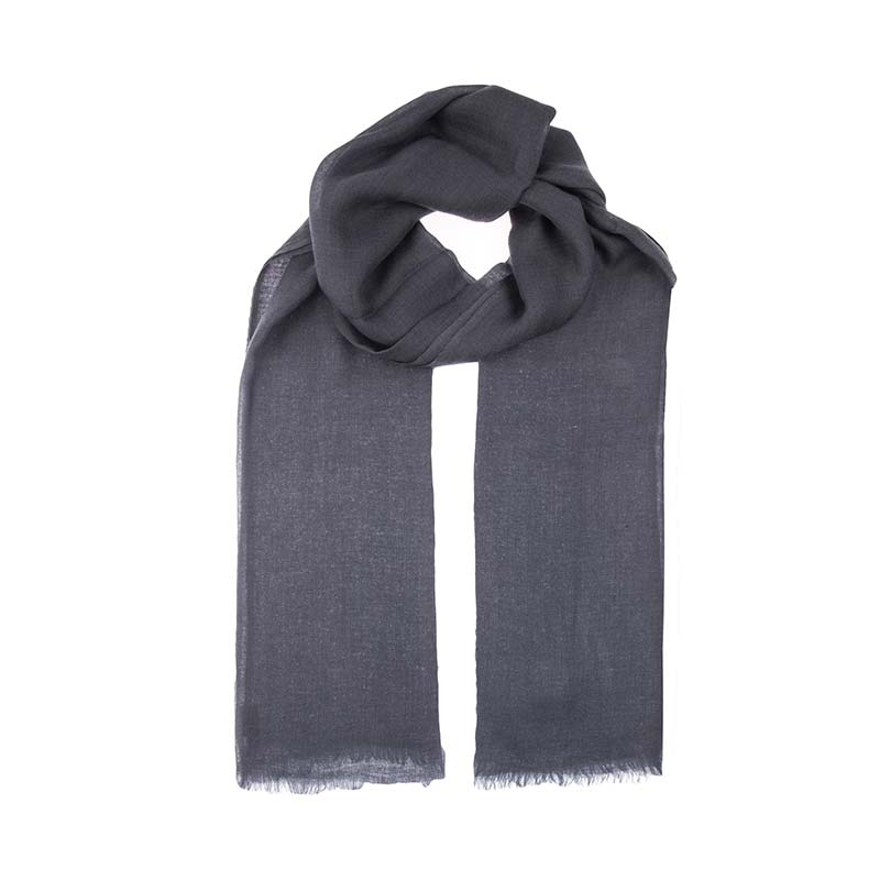 The blue heron is a beautiful grey cashmere shawl. Light weight and floaty this scarf is finely hand woven from 100% cashmere wool. Buy fair trade scarves from Beshlie McKelvie.